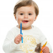 Cute girl holding color wax crayons. — Stock Photo