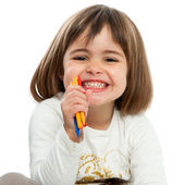 Happy girl with crayons. — Stock Photo