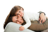 Mother and daughter on couch. — Stock Photo