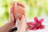 Hands doing foot reflexology. — Stock Photo