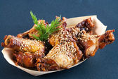 Marinated buffalo wings with sesame seeds. — Stock Photo