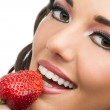Attractive girl eating strawberry. — Stock Photo #24722827