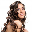 Beautiful brunette with curly hairstyle. — Stock Photo