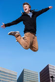 Shouting boy jumping in city. — Stock Photo