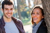 Happy couple laughing in park. — Stock Photo