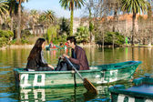 Couple rowing on small boat. — Stock Photo