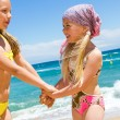 Happy kids in swim wear on beach. — Stock Photo