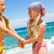 Stock Photo: Happy kids in swim wear on beach.