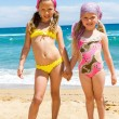 Two girls in swimwear on beach. — Stock Photo