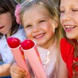 Three kids eating ice cream. — Stock Photo