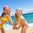 Kids on beach pulling funny faces. — Stock Photo #26854287