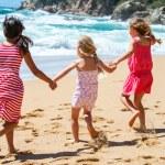 Three girlfriends having fun on beach. — Stock Photo