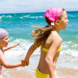 Girls having fun on beach. — Stock Photo