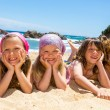 Kids laying on the beach. — Stock Photo