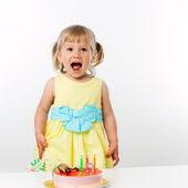 Happy girl with birthday cake. — Stock Photo