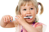 Close up portrait of cute girl brushing teeth. — Stock Photo