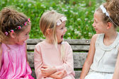 Girl friends having a laugh in park. — Stock Photo