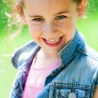 Close up of cute girl with happy smile. — Stock Photo