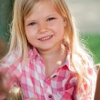 Cute blond girl in park. — Stock Photo #29317447