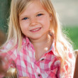 Cute blond girl in park. — Stock Photo