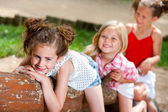 Three girl friends having fun in park. — Stock Photo