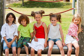 Children siting together in park. — Stock Photo