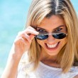 Smiling blond with sunglasses. — Stock Photo
