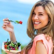 Beautiful woman holding freah salad. — Stock Photo
