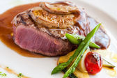 Grilled beef filet with foie gras. — Stock Photo