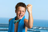 Champion teen swimmer pulling a fist. — Stock Photo