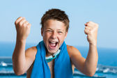 Victorious teen swimmer. — Stock Photo