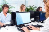 Young people working together in office. — Stock Photo