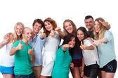 Group of students doing thumbs up. — Stock Photo