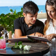 Stock Photo: Young couple looking at menu in restaurant.