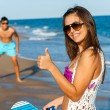 Cute beach tennis player doing thumbs up. — Stock Photo