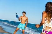 Couple playing beach tennis. — Stock Photo
