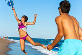 Dynamic beach tennis jump. — Stock Photo