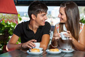 Teen couple enjoying coffee together. — Stock Photo