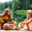 Girlfriends singing together at lake. — Stock Photo