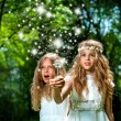 Girls casting magic spells in woods. — Stock Photo #33116325