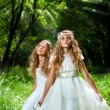 Litte princesses wearing white dresses in woods. — Photo