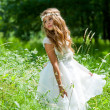 Girl playing with white dress in field. — Stock Photo