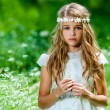 Beautiful pre teen in green field. — Stock Photo #33116373