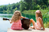 Young girls singing together with guitar. — Stock Photo