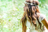 Cute girl wearing headband in field. — Stock Photo