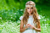 Beautiful pre teen in green field. — Stock Photo