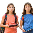 Handicapped twin students with tablets. — Stock Photo