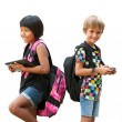 Schoolkids standing with tablet and smartphone. — Stock Photo #33854823