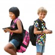 Schoolkids standing with tablet and smartphone. — Stock Photo