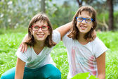 Two handicapped twins embracing outdoors. — Stock Photo